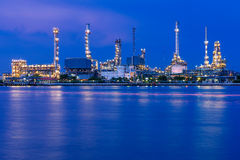 Reflection of a refinery during sunset. Beautiful moment of a refinery during sunset. Reflected light from an oil refinery on the river surface is really Stock Photography
