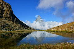 Reflection in the Riffelsee of Matterhorn and cloud under with l Royalty Free Stock Photo