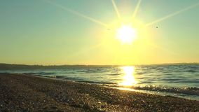 Reflection of the rising sun in the sea stock footage