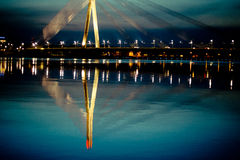 Reflection in the river cable-stayed bridge in Riga City Royalty Free Stock Image