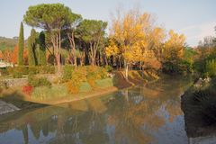 Reflection in river of colorful trees in fall Royalty Free Stock Photos