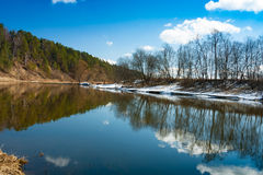 Reflection Of River, Forest, Trees And Blue Sky With Clouds. Stock Images