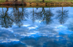 Reflection. On river water as in a mirror Royalty Free Stock Photos