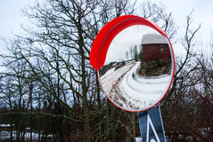 Reflection of road and farm in winter mirror, Norway Stock Photography