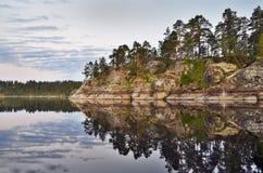 Reflection rocks Stock Image