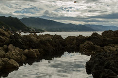 Reflection of rocks in the sea royalty free stock image