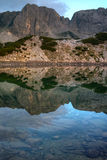 Reflection of rocks in Sinanitsa lake, Pirin Mountain Stock Photos