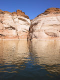 Reflection of Rocky Cliffs in Water Royalty Free Stock Photos