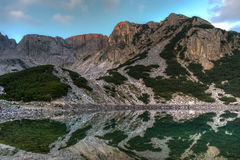 Reflection of rocky peaks in Sinanitsa lake, Pirin Mountain Stock Photo