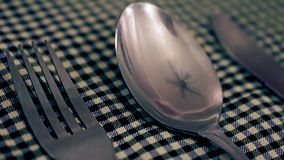 Reflection rotating fan in a spoon. stock footage