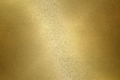 Reflection on rough gold metallic plate surfaces, abstract texture background.  stock images