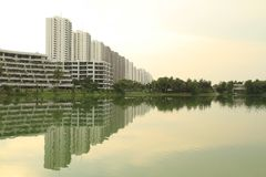 Reflection of row of buildings on the water Stock Photos