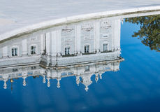 Reflection of Royal Palace. A corner of the Palacio Real de Madrid--the official residence of the Spanish Royal family--reflected in the fountain's pool Royalty Free Stock Photo