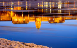 Reflection of the Royal Palace at sunset in the icy Danube River Stock Photo