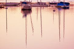 Reflection of sail boats. Royalty Free Stock Image