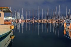 Reflection of sailing boats in Lefkada`s port. royalty free stock photography