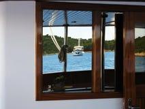 Reflection of sailing ship Stock Photos