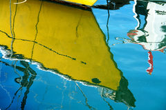 Reflection of a sale boat in the sea Stock Image