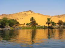 Reflection of a sand dune over the Nile river Stock Photo