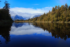 Reflection scenic of lake matheson in south island new zealand Stock Photo