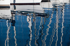 Reflection in a sea of yacht masts Stock Photos