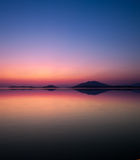 Reflection seascape at twilight. Reflection of coastline in the sea of the harbor of Igoumenitsa (Greece) at twilight Stock Photography