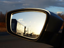 Reflection seen through car side mirror Royalty Free Stock Photo