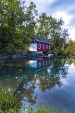 Reflection of Shed in Pond. Morningstar Mill in summer with reflections in water Stock Image