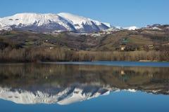Reflection of Sibillini mountain on the San Ruffino lake Royalty Free Stock Photos