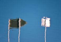 Reflection of signs in the water Stock Images