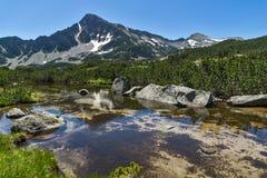 Reflection of Sivrya peak in Banski lakes, Pirin Mountain Royalty Free Stock Image