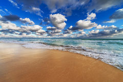 Reflection of sky in the beach Stock Image