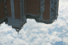 Reflection of sky, clouds and building on the water. Reflection of the sky, clouds and building on the water stock photo