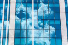Reflection of the sky and clouds in building windows Royalty Free Stock Photo