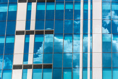 Reflection of the sky and clouds in building windows Royalty Free Stock Images