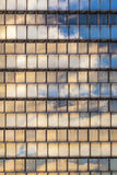 Reflection of sky and clouds in the  facade of a skyscraper Royalty Free Stock Image