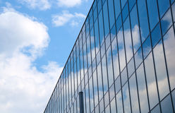 Reflection of the sky and clouds in Glass facade of a building Royalty Free Stock Image