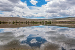 Lake steppe sky clouds reflection Stock Photo