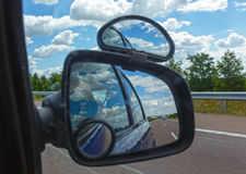 Reflection of sky with clouds in mirror. Stock Photography
