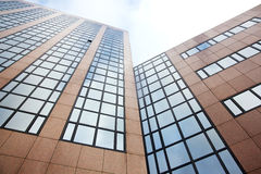 Reflection of sky and clouds in modern office building Royalty Free Stock Photos