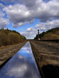 Reflection of sky with clouds in polished rail Royalty Free Stock Photo