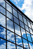 Reflection of the sky and clouds in the windows of  building Stock Photo