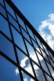 Reflection of the sky and clouds in the windows of  building Royalty Free Stock Image
