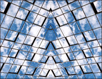 Reflection of sky and clouds in the Windows. Symmetrical Stock Image