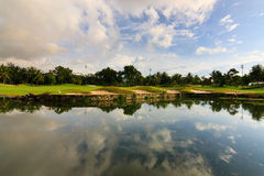 Reflection of sky at a golf course lake Stock Photo