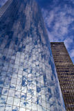 Reflection of the sky in Manhattan towers Stock Photos