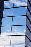 The reflection of the sky mirrored building Stock Images