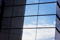 The reflection of the sky mirrored building Royalty Free Stock Photos