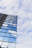 The reflection of the sky mirrored building Stock Photos