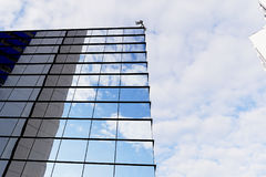 The reflection of the sky mirrored building Stock Photo